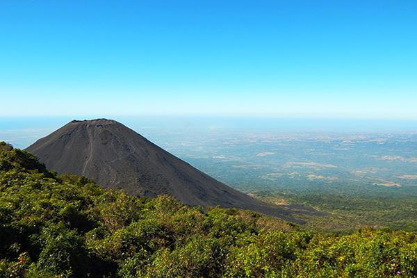 A volcano sits mightily over the land in El Salvador, Central America
