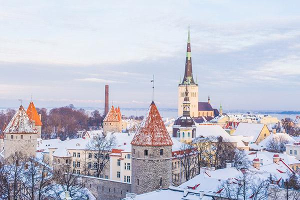 Historic buildings are covered in snow on a cold winter's day in Tallinn, Estonia
