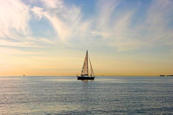 A sailboat floats calmly by in the waters outside of Tallinn, Estonia