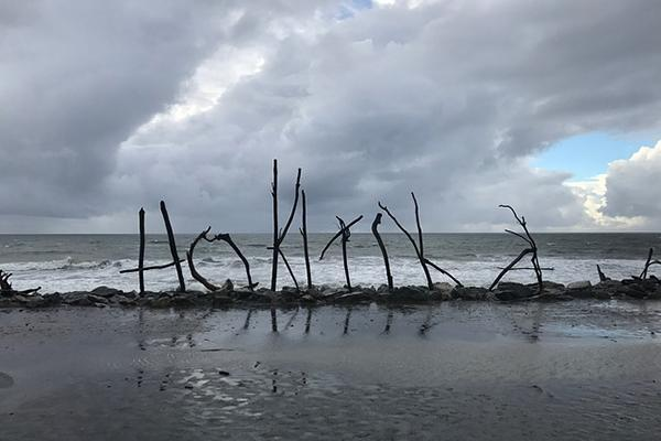 Hokitika spelled out with sticks on the west coast of New Zealand's South Island