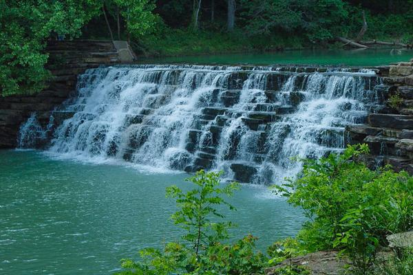 A waterfall flows steadily in Devil's Den State Park just outside of Fayetteville, Arkansas