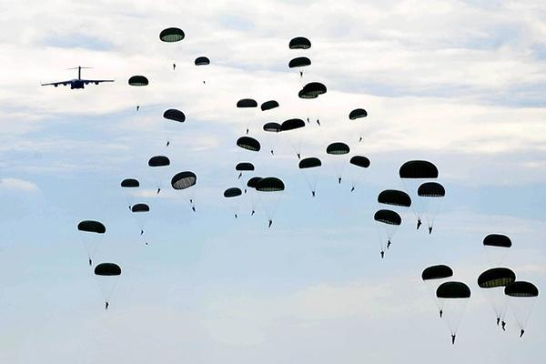 Dozens of parachutists drop from the sky in Fayetteville, North Carolina