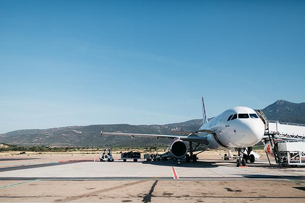 A plane arrives at Figari Airport In the South of Corsica on a beautiful day in France