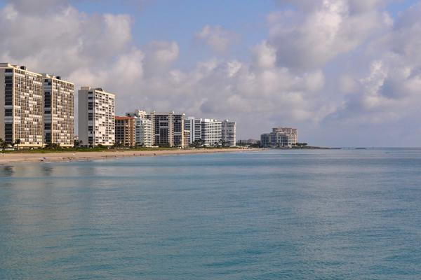 The blue waters of Boca Raton, Florida in front of apartment buildings along the beach