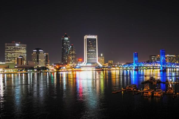 Downtown Jacksonville, with its famous Blue Bridge, shines brightly at night in Florida