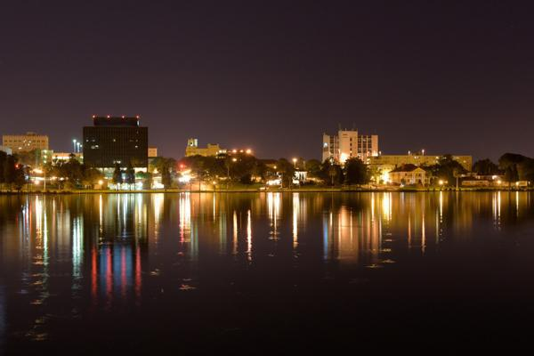 The city lights reflect off of the water at night in Lakeland, Florida
