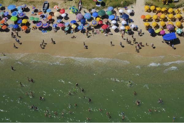 Colourful umbrellas dot Florianopolis beaches