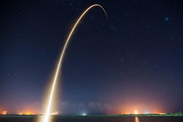A rocket launches into space at night in Cape Canaveral, Florida