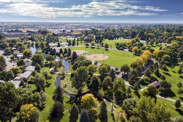 Edora Park is adorned with bright green trees in Fort Collins, Colorado