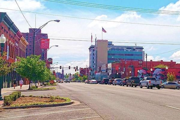 A small line up of cars stop at a red light in downtown Fort Smith, Arkansas