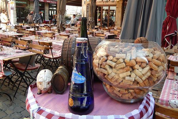 A bowl of corks set the scene for the quaint little restaurant, Bouchon in Lyon, France