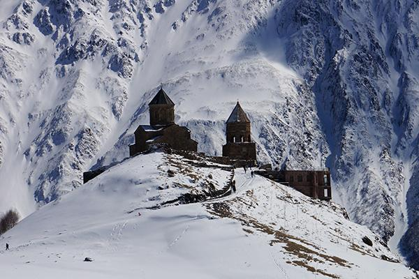 A winter view of the Tsminda Sameba Church at the foot of Mt Kazbek, near Kazbegi in Georgia
