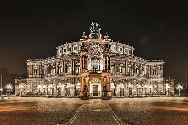 The grand Semper Opera House illuminated at night in Dresden, Germany