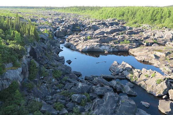 Low levels of water expose the banks of the Churchill River in Goose Bay, Canada
