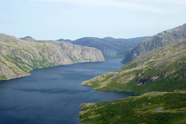 A body of water carves its way through the Mealy Mountains near Goose Bay, Canada