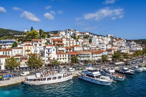 Ships line up along the vibrant Skiathos Harbour in Greece