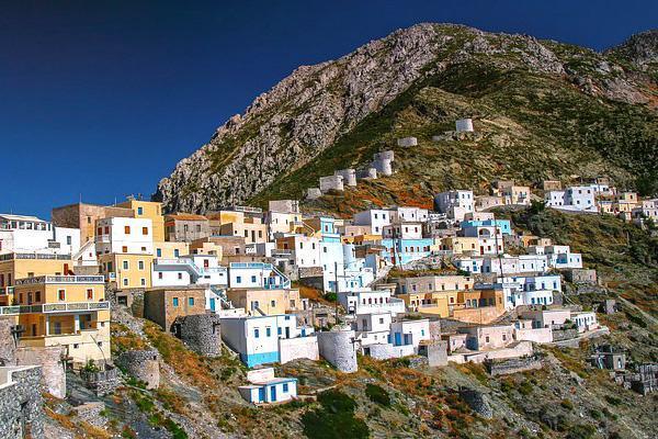 Colourful cliffside buildings in Karpathos, Greece