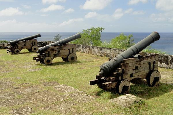 Old cannons face the sea on the Micronesian island of Guam