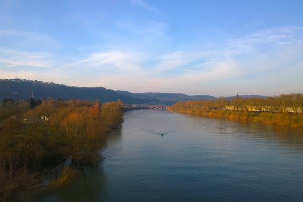 The tranquil Moselle River flows through the town of Trier near Hahn, Germany