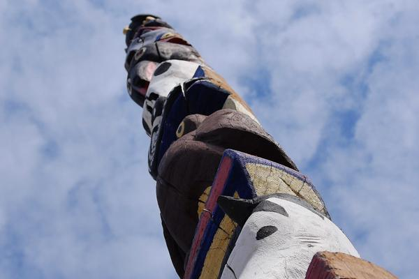 A hand-carved totem pole welcomes visitors to High Level, Canada