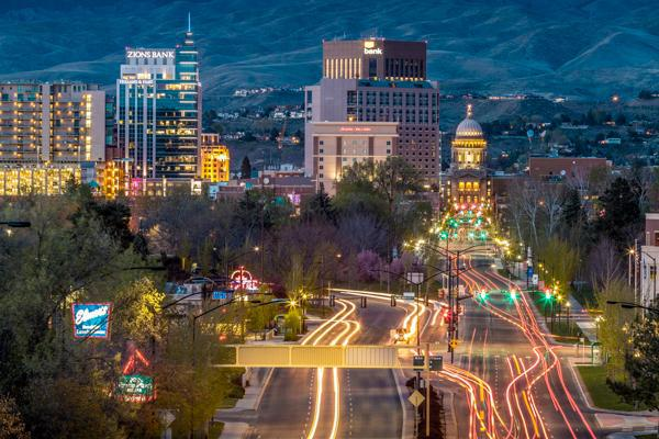 Traffic flows into downtown Boise, Idaho at night