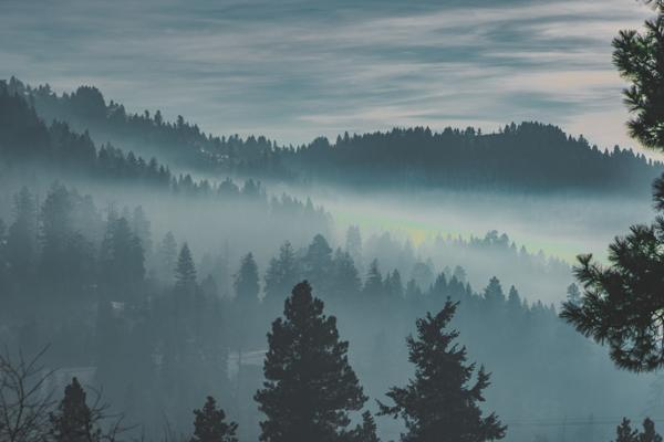 Fog rolls in over the hills at Bogus Basin Recreation Area in Boise, United States