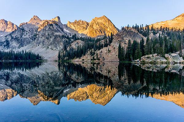 Mountains reflect on the water at Sawtooth National Forest, Idaho