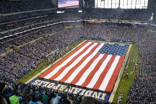 Fans stand during the National Anthem before an Indianapolis Colts NFL game in Indiana