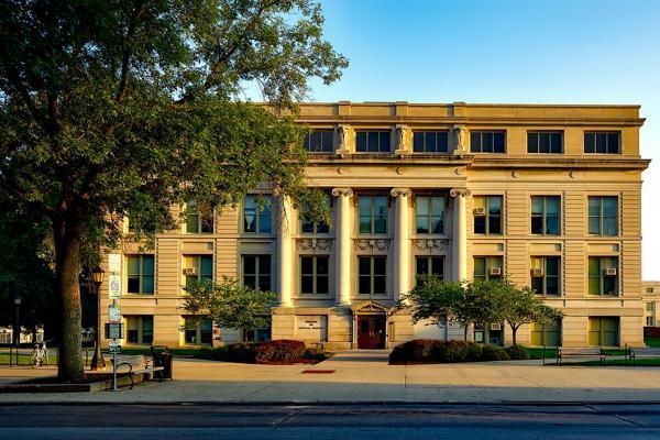 Daylight fades on the historic University of Iowa building in Iowa City, Iowa