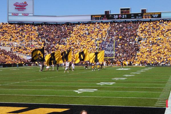 Fans adorn themselves in the colours of the University of Iowa Hawkeyes in Iowa City