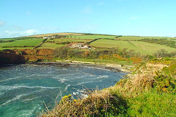 ALT: The beach at Port Grenaugh from the nearby Promontory Fort site on the Isle of Man