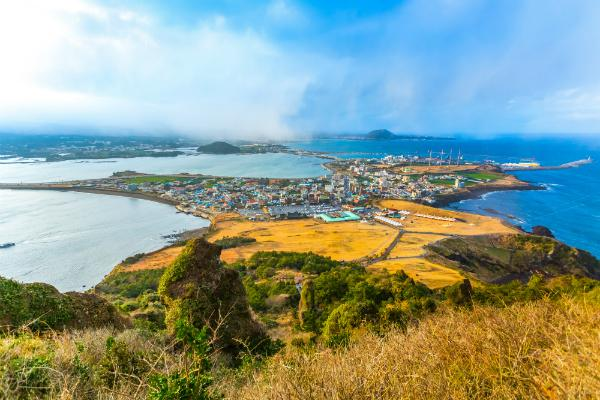 Jeju island is green against a blue sea