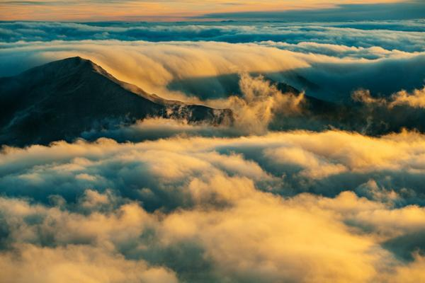The early morning fog rolls over the Haleakala Mountain near Kahului, Hawaii