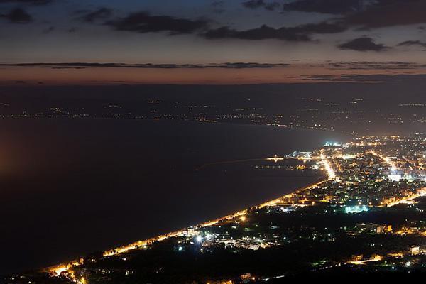 A nighttime aerial view of Kalamata, Greece