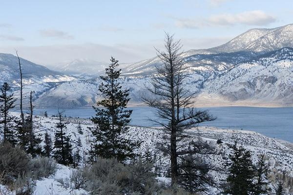 Mountains surround a snow dusted Kamloops Lake in Kamloops, British Columbia, Canada