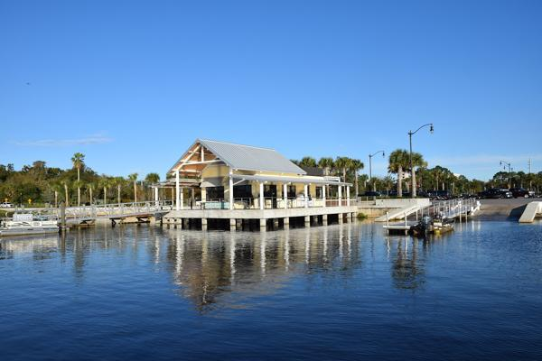 The tranquil waters reflect the dockside bait and tackle shop in Kissimmee, Florida