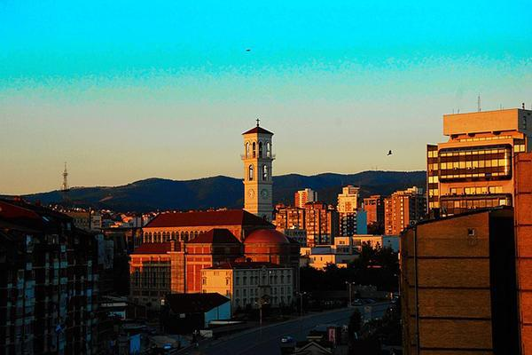 The uniquely beautiful architecture of Kosovo being painted with the light of dawn