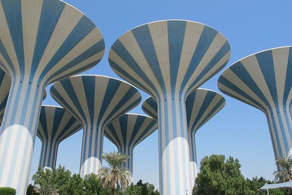 Giant striped water towers reach toward the sky in Kuwait