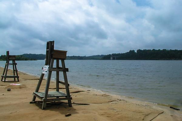A lifeguards' chair sits empty on the shores of Barren River Lake State Resort Park in Glasgow, Kentucky
