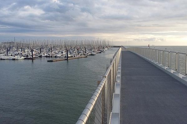 A pathway leads out toward a marina filled with countless boats in La Rochelle, France
