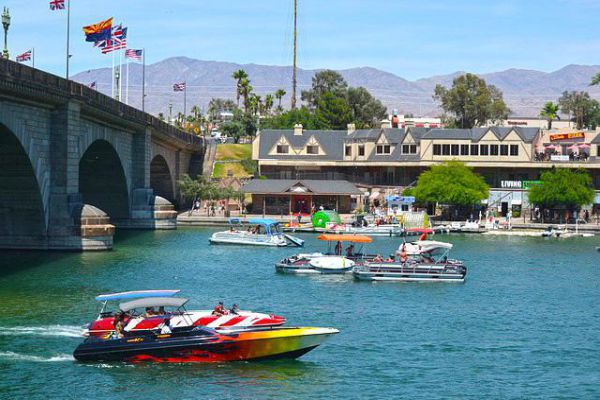 Boats fill the water next to the London Bridge in Lake Havasu City, Arizona