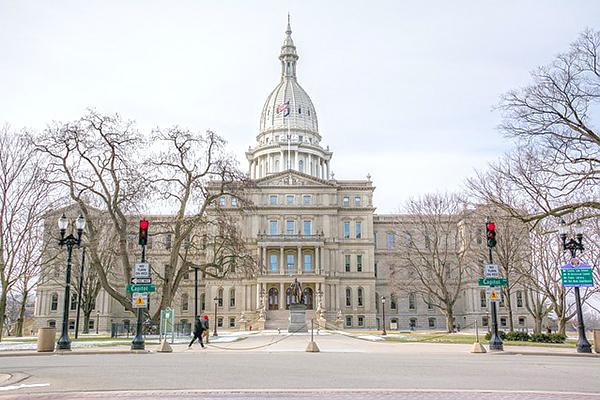 Frontal view of the Michigan State Capitol building in Lansing