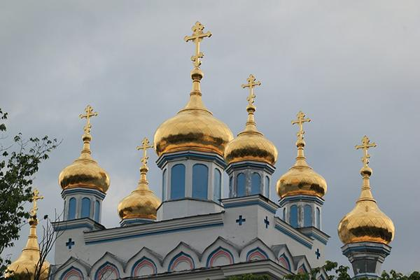 Golden crosses top a Russian-style church in Daugavpils, Latvia