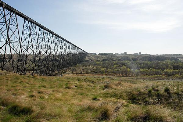 The Lethbridge River Valley bridge reaches across the iconic rolling hills of the Alberta prairies in Canada