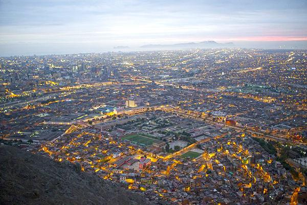 Aerial view of Lima's cityscape at dusk in Peru