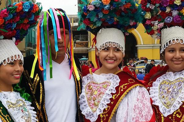 Dancers in costume at a parade in Lima, Peru