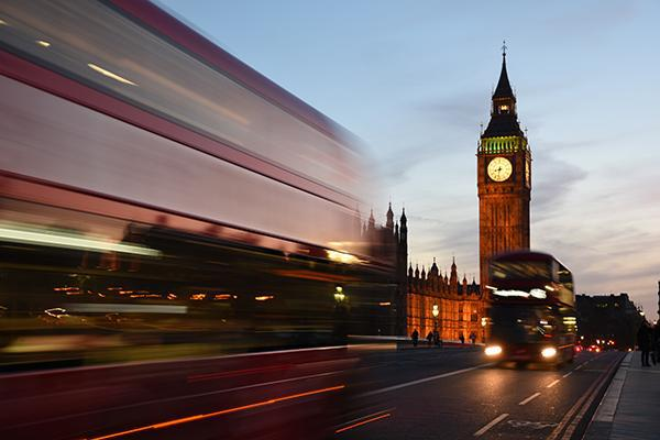 The hustle and bustle of central London, United Kingdom with a double decker bus and Big Ben the main focus