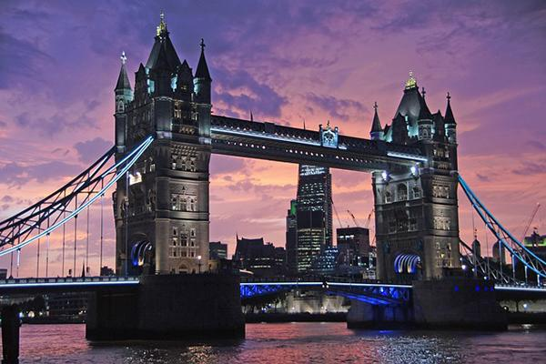 The Tower Bridge stands mightily over the Thames at sunset in London, England