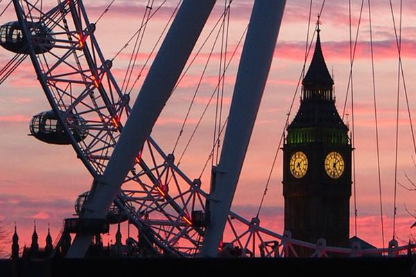 The London Eye and Big Ben looking grand as the sun sets in London, England