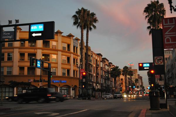 Traffic flows through the city of Long Beach, California at sunset